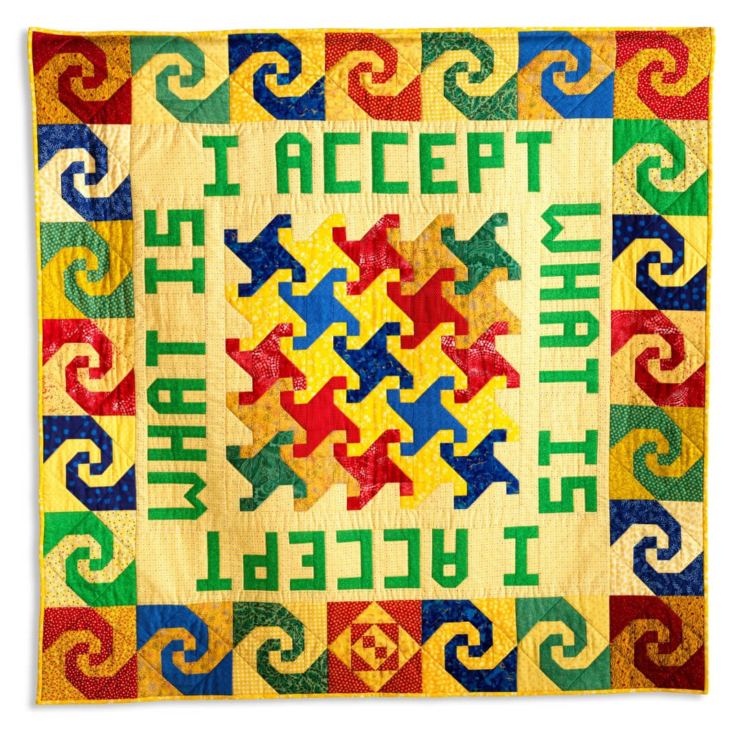 A quilt-with-words is shown. The words say: I Accept What Is